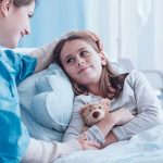 child-with-teddy-bear-in-hospital-bedx